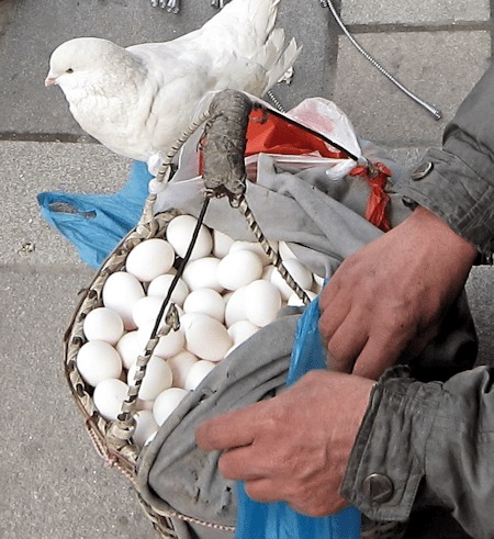 A man selling his eggs on the street In Shanghai, China