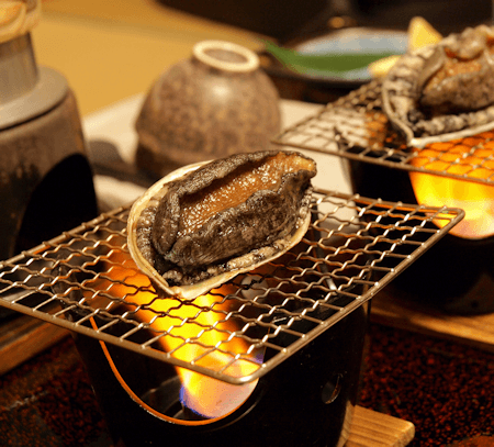 Table side barbecue abalone in Japanese Ryokan