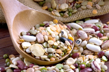 Mix of legumes in a wooden spoon
